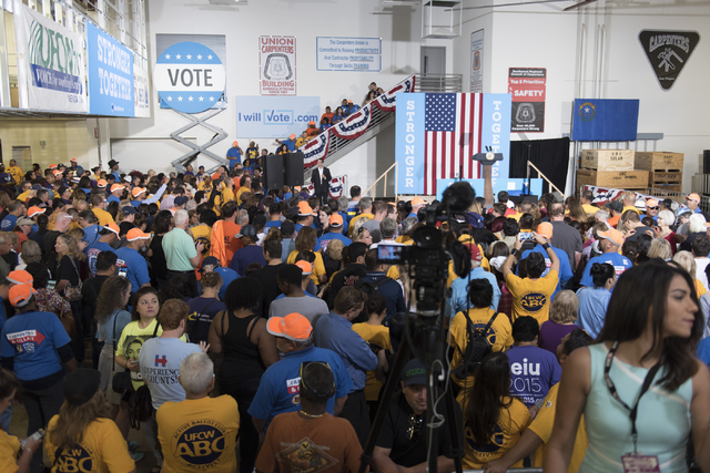 Hillary Clinton supporters wait for Vice President Joe Biden to speak during a campaign rally for presidential candidate Hillary Clinton at the Southwest Regional Council of Carpenters office in L ...