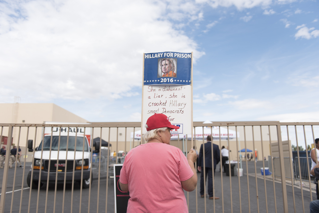 A presidential candidate Donald Trump supporter waits outside of the Southwest Regional Council of Carpenters office as Vice President Joe Biden speaks to presidential candidate Hillary Clinton su ...