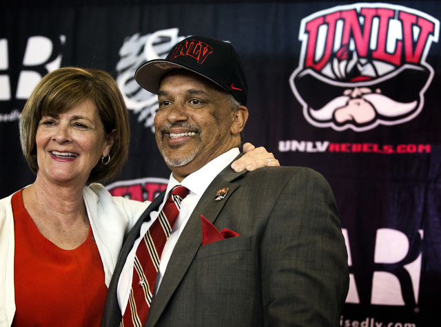 UNLV Director of Athletics Tina Kunzer-Murphy, left,  introduces new UNLV men's basketball coach Marvin Menzies during a press conference at Mendenhall Center on Friday, April 22, 2016. (Jeff Sche ...