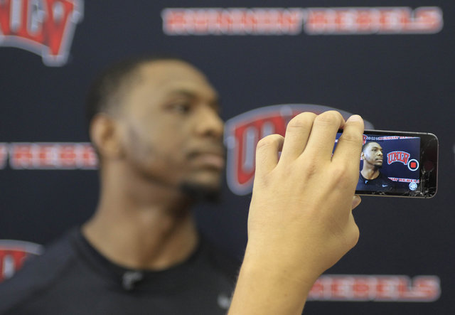 UNLV senior Christian Jones is seen on a camera screen as he takes questions from the media before team practice at the Mendenhall Center at UNLV in Las Vegas on Monday, Aug. 8, 2016. Richard Bria ...
