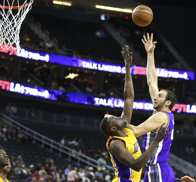 Sacramento Kings guard Arron Afflalo (40) sends a shot over Los Angeles Lakers forward Luol Deng (9) during a preseason basketball game at the T-Mobile Arena in Las Vegas on Thursday, Oct. 13, 201 ...