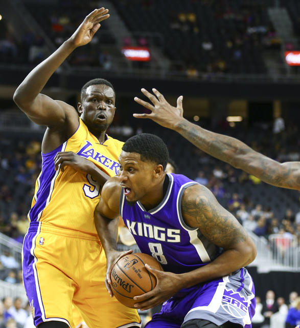 Sacramento Kings forward Rudy Gay (8) looks for an open shot as Los Angeles Lakers forward Luol Deng (9) defends during a preseason basketball game at the T-Mobile Arena in Las Vegas on Thursday,  ...
