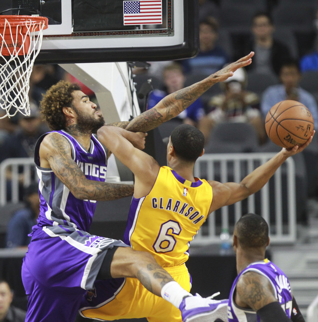 Sacramento Kings center Willie Cauley-Stein (00) fouls Los Angeles Lakers guard Jordan Clarkson (6) during a preseason basketball game at the T-Mobile Arena in Las Vegas on Thursday, Oct. 13, 2016 ...