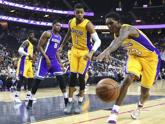 Los Angeles Lakers guard Louis Williams (23) reaches out to get control of a rebound as Los Angeles Lakers guard D'Angelo Russell (1) and Sacramento Kings forward Rudy Gay (8) look on during a pre ...