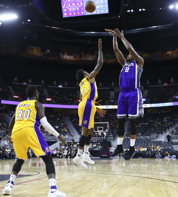Sacramento Kings forward Rudy Gay (8) goes up for a shot over Los Angeles Lakers forward Nick Young (0) during a preseason basketball game at the T-Mobile Arena in Las Vegas on Thursday, Oct. 13,  ...