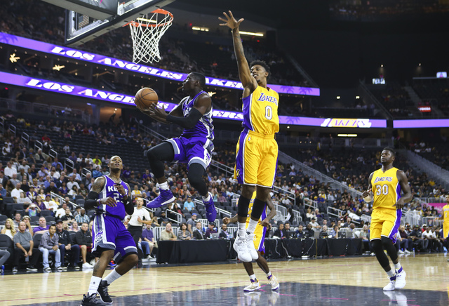 Sacramento Kings guard Darren Collison (7) goes up for a shot as Los Angeles Lakers forward Nick Young (0) defends during a preseason basketball game at the T-Mobile Arena in Las Vegas on Thursday ...