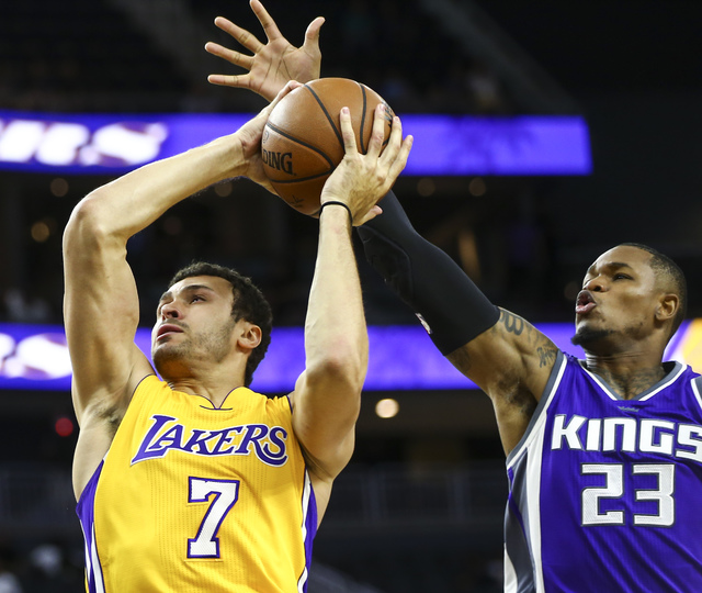 Los Angeles Lakers forward Larry Nance Jr. (7) is fouled by Sacramento Kings guard Ben McLemore (23) during a preseason basketball game at the T-Mobile Arena in Las Vegas on Thursday, Oct. 13, 201 ...