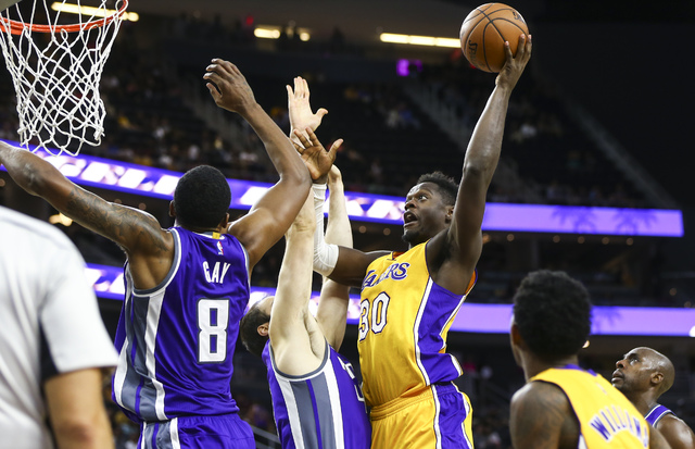 Los Angeles Lakers forward Julius Randle (30) goes up to score a shot against the Sacramento Kings during a preseason basketball game at T-Mobile Arena on Thursday, Oct. 13, 2016, in Las Vegas. Th ...