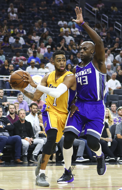 Los Angeles Lakers guard D'Angelo Russell (1) looks to pass the ball as Sacramento Kings forward Anthony Tolliver (43) defends during a preseason basketball game at the T-Mobile Arena in Las Vegas ...