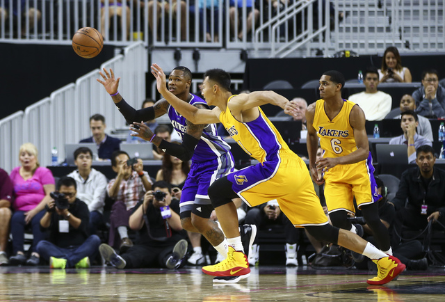 Sacramento Kings guard Ben McLemore (23) and Los Angeles Lakers forward Yi Jianlian (11) fight to gain control of the ball during a preseason basketball game at the T-Mobile Arena in Las Vegas on  ...