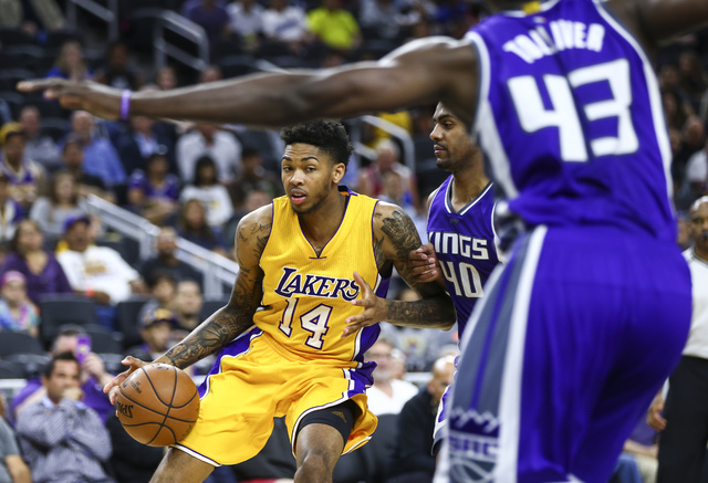 Los Angeles Lakers forward Brandon Ingram (14) drives the ball against Sacramento Kings guard Arron Afflalo (40) during a preseason basketball game at the T-Mobile Arena in Las Vegas on Thursday,  ...