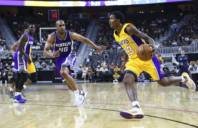 Los Angeles Lakers guard Louis Williams (23) drives towards the basket as Los Angeles Lakers center Ivica Zubac (40) looks to defend during a preseason basketball game at the T-Mobile Arena in Las ...