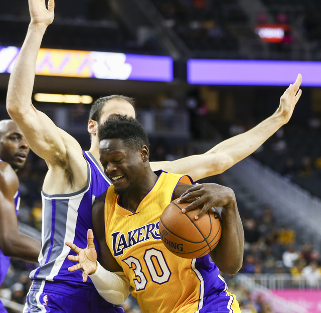 Los Angeles Lakers forward Julius Randle (30) tries to get past Sacramento Kings center Kosta Koufos (41) during a preseason basketball game at the T-Mobile Arena in Las Vegas on Thursday, Oct. 13 ...