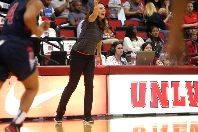 UNLV women's basketball coach Kathy Olivier gives instruction to her team as the Lady Rebels take on Dixie State in the second half of an exhibition game at the Cox Pavilion Monday, Nov. 10, 2014. ...