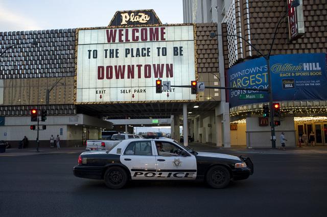 Officers look out their window to a Black Lives Matter demonstration on Main Street, downtown Las Vegas on Friday evening, July 8, 2016. (Bridget Bennett/Las Vegas Review-Journal) Follow @bridgetk ...