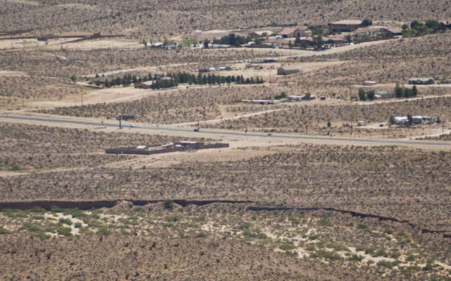 Cars drive by the proposed site of a road that would lead to a possible community inside the Blue Diamond Hill Gypsum mine near the town of Blue Diamond on Thursday, Aug. 11, 2016. (Daniel Clark/L ...