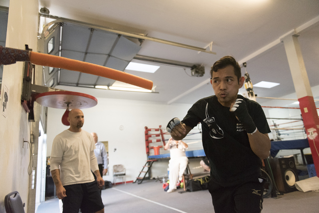 Nonito Donaire, right, trains at Bones Adams Boxing Gym in Las Vegas on Monday, Oct. 17, 2016, to defend his Super Bantamweight title against Jessie Magdaleno at a Nov. 5 fight at the Thomas & ...