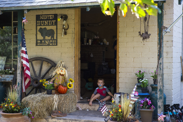 A grandson of Cliven Bundy sits in a doorway at Bundy Ranch in Bunkerville on Friday, Oct. 28, 2016. Members of an armed group that staged a takeover of the Malheur National Wildlife Refuge near B ...