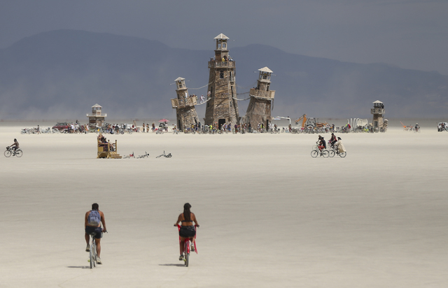 The Black Rock Lighthouse Service installation is shown in the distance during Burning Man at the Black Rock Desert north of Reno on Wednesday, Aug. 31, 2016. (Chase Stevens/Las Vegas Review-Journ ...