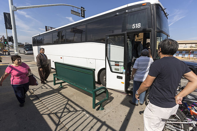 Casino-bound travelers board a tour bus in Los Angeles recently. (Damian Dovarganes/The Associated Press)