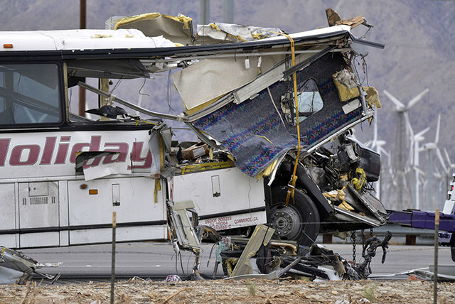 This Oct. 23 photo shows the wreckage of a tour bus that collided with a big rig on Interstate 10 in Desert Hot Springs, Calif., near Palm Springs, Calif. (Rodrigo Peña/The Associated Press)