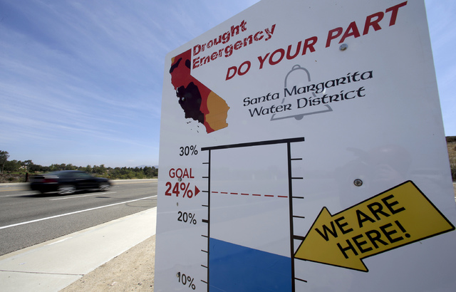 Cars pass by a sign encouraging residents to save water in Rancho Santa Margarita, Calif., in 2015. (Chris Carlson/The Associated Press)