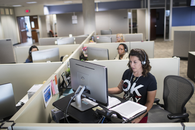 Melissa DeVarona, front, takes calls at NV Energy in Las Vegas on Wednesday, Oct. 26, 2016. Loren Townsley/Las Vegas Review-Journal Follow @lorentownsley