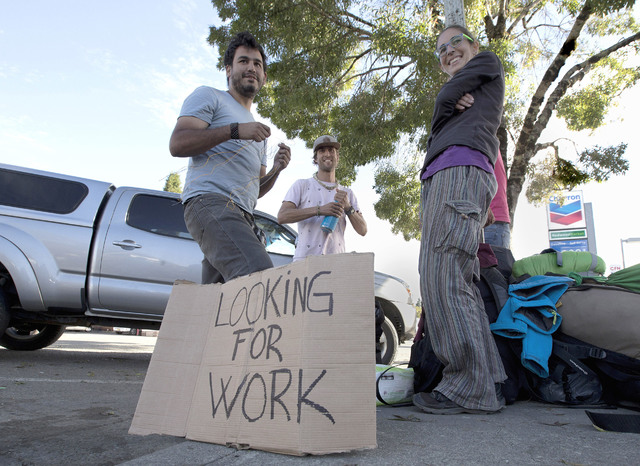 "Rachel Perez, 22, right, who traveled from Spain with three companions seeks work as a marijuana ""trimmer"" in Garberville, Calif. (Rich Pedroncelli/The Associated Press)"