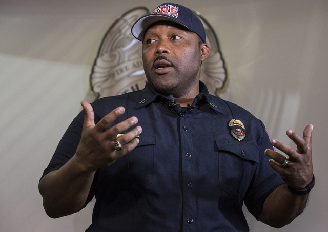 Capt. Cedric Williams, public information officer for the North Las Vegas Fire Department, answers questions during a press conference to announce the death of his friend and colleague Capt. Yaphe ...