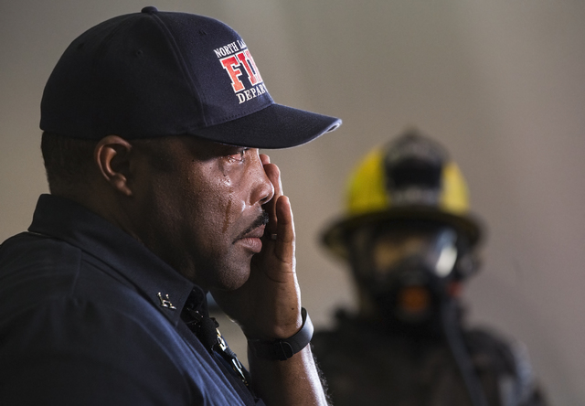 Capt. Cedric Williams, public information officer for the North Las Vegas Fire Department, wipes away tears during a press conference to announce the death of his friend and colleague Capt. Yaphet ...