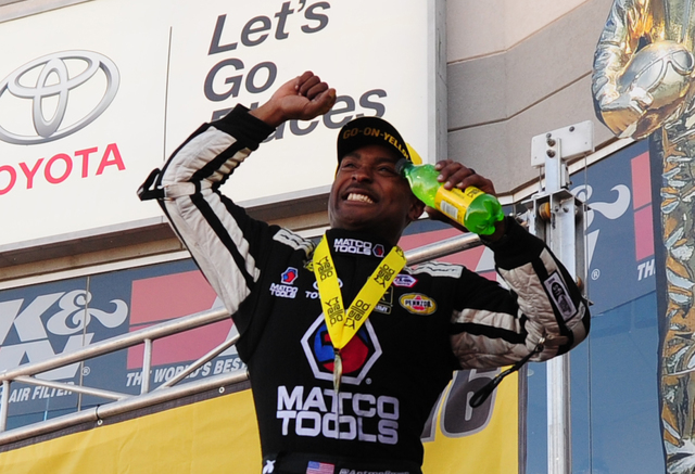 NHRA Top Fuel driver Antron Brown celebrates winning the DENSO Spark Plugs NHRA Nationals at The Strip at Las Vegas Motor Speedway in Las Vegas Sunday, April 3, 2016.  (Josh Holmberg/Las Vegas Rev ...
