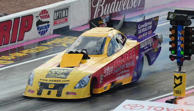 The burst panel onboard the Funny Car driven by Bob Bode pops off in the first qualifying session for the NHRA Mello Yello Series Toyota Nationals at The Strip at Las Vegas Motor Speedway in Las V ...