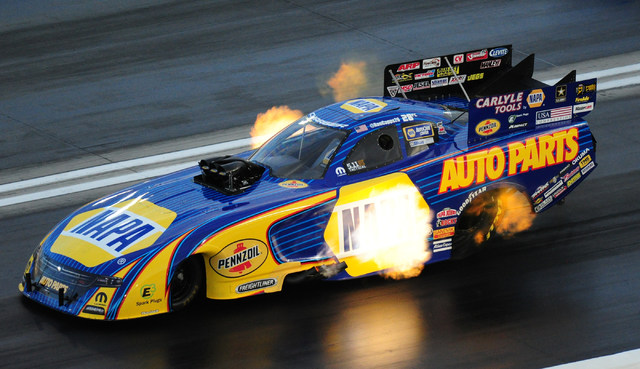 Funny Car driver Ron Capps lays down a pass of 326.71 MPH at 3.881 elapsed time during the second qualifying session for the NHRA Mello Yello Series Toyota Nationals at The Strip at Las Vegas Moto ...