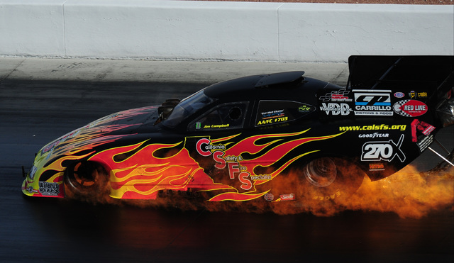 The Funny Car driven by Jim Campbell catches fire during the third qualifying session for the NHRA Mello Yello Series Toyota Nationals at The Strip at Las Vegas Motor Speedway in Las Vegas Saturda ...