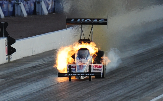 The engine onboard the Top Fuel dragster driven by Richie Crampton explodes during the final qualifying session for the NHRA Mello Yello Series Toyota Nationals at The Strip at Las Vegas Motor Spe ...