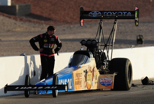 A dejected Morgan Lucas looks at his Top Fuel dragster after failing to qualify for the NHRA Mello Yello Series Toyota Nationals at The Strip at Las Vegas Motor Speedway in Las Vegas Saturday, Oct ...