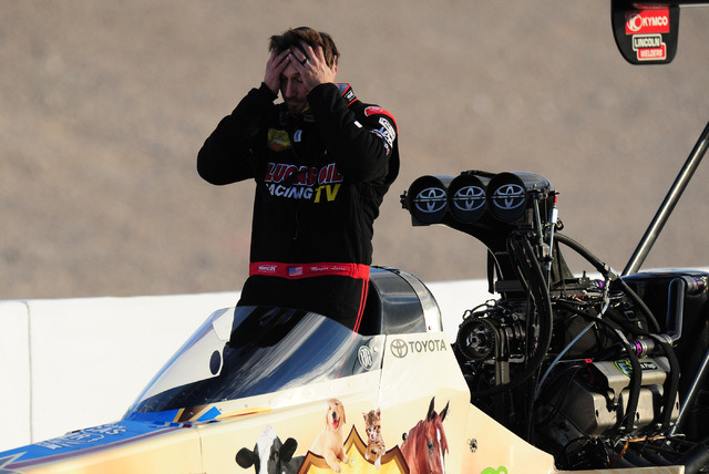 A dejected Morgan Lucas is seen while being pushed off track at after failing to qualify during the final qualifying session for the NHRA Mello Yello Series Toyota Nationals at The Strip at Las Ve ...