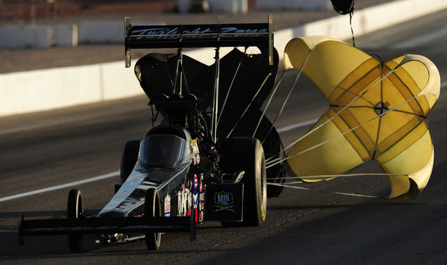 Top Fuel driver Scott Palmer lays down a pass of 302.28 MPH at 3.951 seconds elapsed time during the final qualifying session for the NHRA Mello Yello Series Toyota Nationals at The Strip at Las V ...