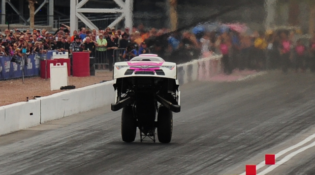 NHRA Funny Car driver Cruz Pedregon does an unusual wheelie while racing alongside Robert Hight during the first round of eliminations during the NHRA Mello Yello Series Toyota Nationals at The St ...