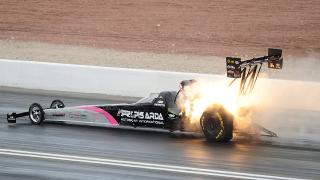 The engine onboard the Top Fuel dragster driven by Wayne Newby explodes during the first round of eliminations during the NHRA Mello Yello Series Toyota Nationals at The Strip at Las Vegas Motor S ...