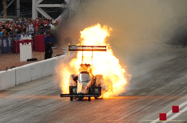 The engine onboard the Top Fuel dragster driven by Scott Palmer explodes during the first round of eliminations during the NHRA Mello Yello Series Toyota Nationals at The Strip at Las Vegas Motor  ...
