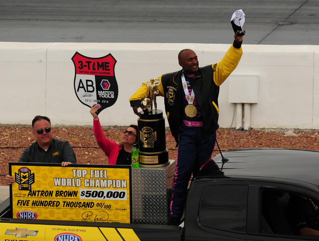 Top Fuel driver Antron Brown waves to the crowd after clinching the 2016 Top Fuel World Championship during the second round of eliminations during the NHRA Mello Yello Series Toyota Nationals at  ...