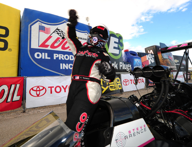 Top Fuel driver Steve Torrence celebrates after winning the NHRA Mello Yello Series Toyota Nationals at The Strip at Las Vegas Motor Speedway in Las Vegas Sunday, Oct. 30, 2016. Cruz was shaken bu ...