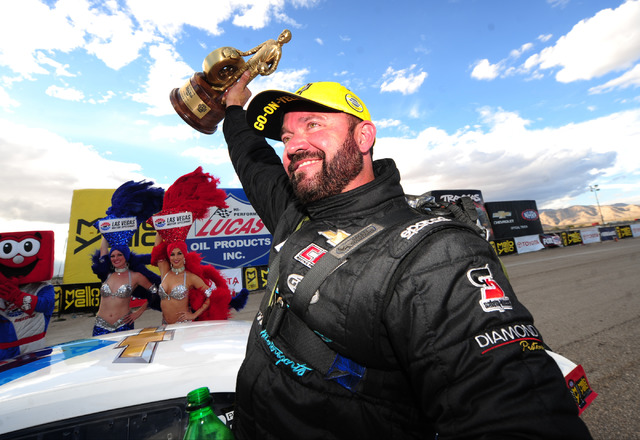 NHRA Pro Stock driver Shane Gray celebrates after winning the NHRA Mello Yello Series Toyota Nationals at The Strip at Las Vegas Motor Speedway in Las Vegas Sunday, Oct. 30, 2016. Cruz was shaken  ...