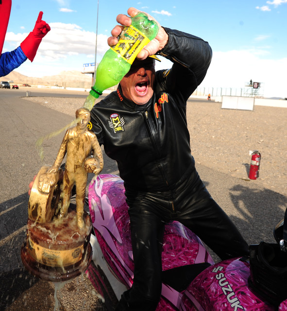NHRA Pro Stock Motorcycle rider Jerry Savoie celebrates after winning the NHRA Mello Yello Series Toyota Nationals at The Strip at Las Vegas Motor Speedway in Las Vegas Sunday, Oct. 30, 2016. Cruz ...