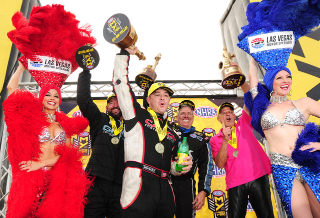 Drivers Shane Gray, from left, Steve Torrence, John Force and Jerry Savoie celebrate after winning in their respective classes during the NHRA Mello Yello Series Toyota Nationals at The Strip at L ...