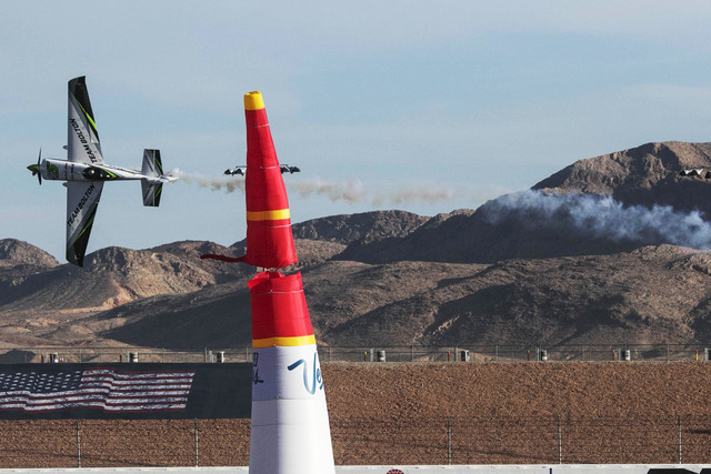 Chilean pilot Cristian Bolton hits a pylon race marker as he flies an Edge 540 V2 on the final day of the Red Bull Air Race World Championship at the Las Vegas Motor Speedway, Sunday, Oct. 16, 201 ...