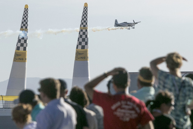 A crowd watches as Chilean pilot Cristian Bolton crosses the finish line on the final day of the Red Bull Air Race World Championship at the Las Vegas Motor Speedway, Sunday, Oct. 16, 2016. (Richa ...
