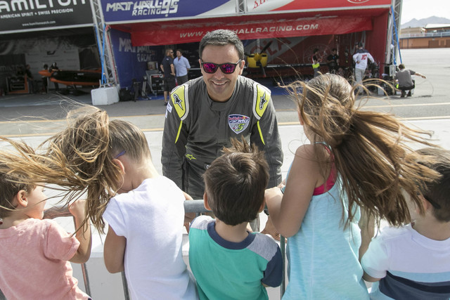 Chilean air race pilot Cristian Bolton greets a group of youngsters on the final day of the Red Bull Air Race World Championship at the Las Vegas Motor Speedway, Sunday, Oct. 16, 2016. (Richard Br ...