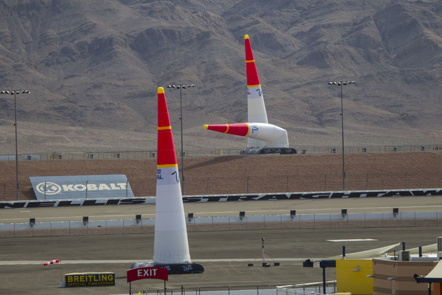 An air race pylon marker is blown over in strong winds on the final day of the Red Bull Air Race World Championship at the Las Vegas Motor Speedway, Sunday, Oct. 16, 2016. (Richard Brian/Las Vegas ...